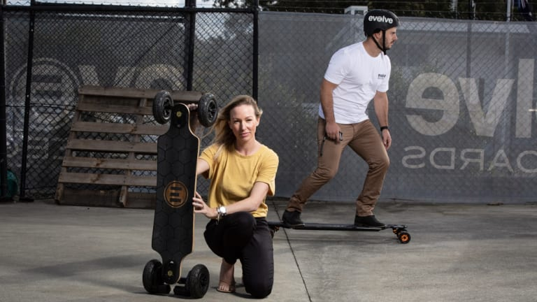 Fleur Anning and Evolve Skateboards chief executive Paul Harris at Evolve's factory on the Gold Coast.
