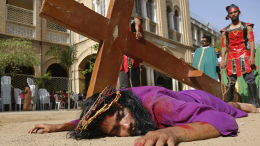 Students re-enact the crucifixion of Jesus Christ to mark Good Friday in Ahmedabad, India.