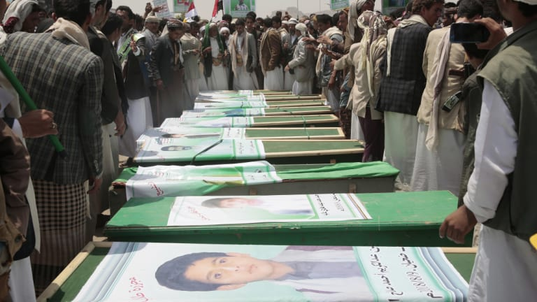 Yemeni people attend the funeral of victims of a Saudi-led airstrike, in Saada, Yemen.