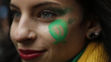 A pro-choice demonstrator participates in a concentration to support an abortion legalisation law, in Buenos Aires.