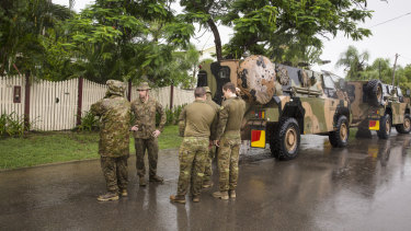 Army personnel assisting with flood evacuations in Rosslea, Townsville, on Saturday.