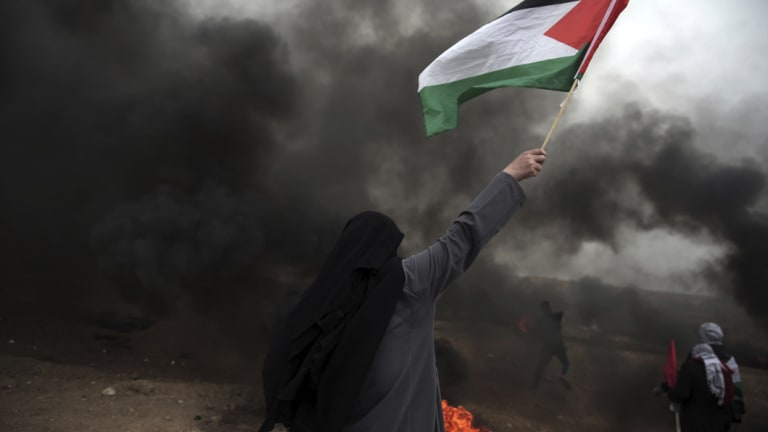 Palestinians burn tyres during a protest at the Gaza Strip's border with Israel on May 4.