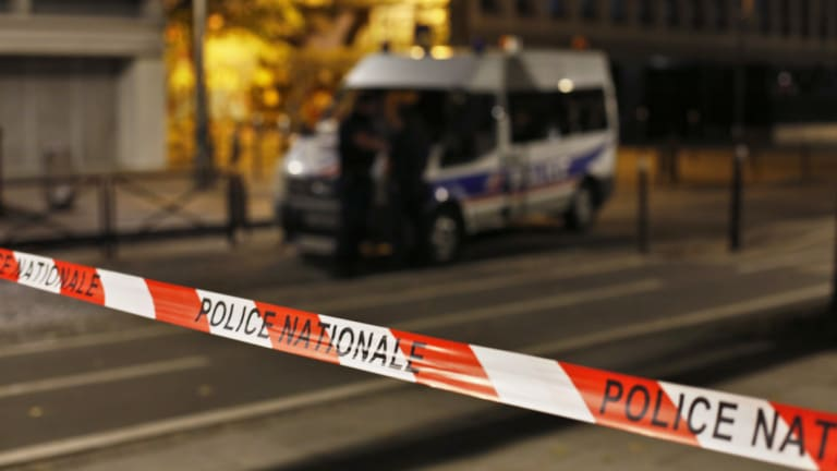 Police secures the site of a knife attack in Paris.