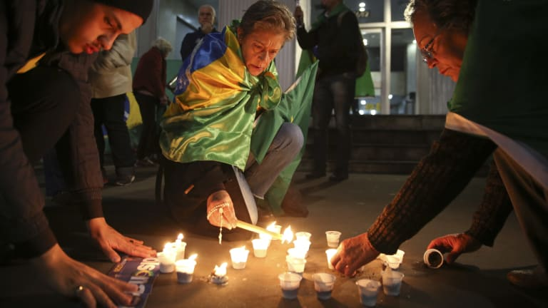 People light candles in support of Jair Bolsonaro, Brazil's Presidential candidate, who was stabbed during a campaign event, in Sao Paulo, Brazil.