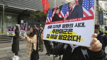 Protesters with banners of US President Donald Trump and North Korean leader Kim Jong-un stage a rally in Seoul, South Korea.