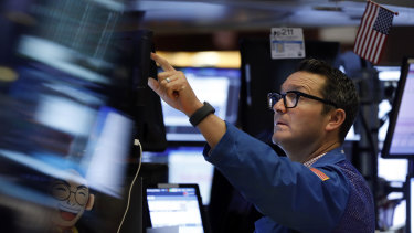 Wall Street is higher in afternoon trade as it looks to end its four-session losing streak.