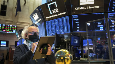 Trader Peter Tuchman on the floor of the New York Stock Exchange: With unemployment rising in the pandemic, investors are looking to more stimulus from the incoming Biden administration.