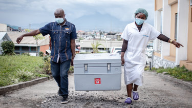 A shipment of COVAX AstraZeneca doses arrives in the Democratic Republic of Congo. Many poorer nations struggle to store and ship the doses they receive.