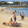 'Stuff it, it's hot': Hundreds ignore lockdown rules at St Kilda beach