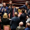 Italian Prime Minister Giuseppe Conte, centre, is congratulated at the end of his resignation address to the Senate, in Rome.