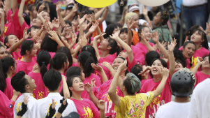 Dancers cheer during the National Day celebrations in Taipei.