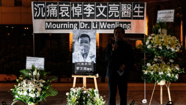 People attend a vigil to mourn for doctor Li Wenliang in Hong Kong, China.