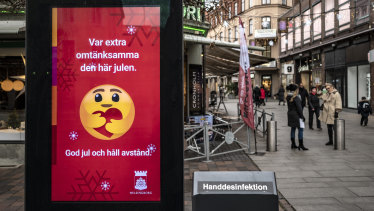 A public information sign wishes Merry Christmas and asks people to maintain social distancing in Helsingborg, southern Sweden.