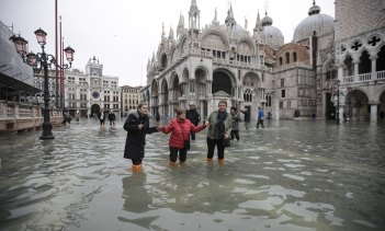 People wade through a flooded St Mark's Square in Venice, Italy, this week.