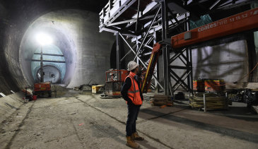 A worker surveys the Victoria Cross Metro station cavern in North Sydney.