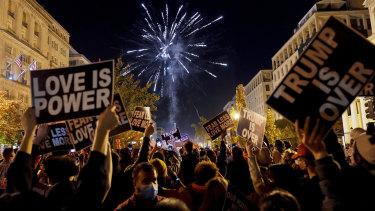 People shoot off fireworks in Black Lives Matter Plaza while celebrating president-elect Joe Biden's win over President Donald Trump.