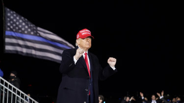 US President Donald Trump dances to YMCA during a rally in Janesville, Wisconsin in October.
