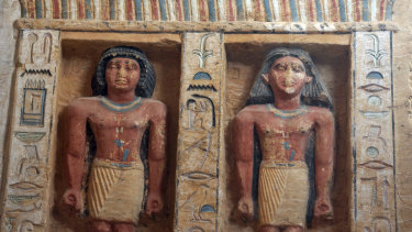 Relief statues are seen at the recently uncovered tomb of the Priest royal Purification.