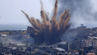 Smoke rises following an Israeli airstrike on a building in Gaza City on Thursday.