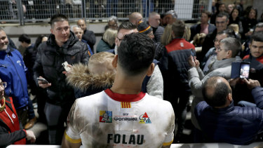 Folau poses with fans after the match.