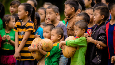The world game: Children watch on intently at their first rugby training clinic.