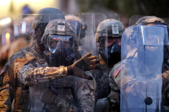 Georgia National Guard troops prepare to enforce a 9:00 pm curfew in Atlanta on Tuesday.