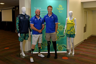 Wheelchair rugby player Chris Bond and paracanoeist Curtis McGrath with some of the new team outfits for the Tokyo 2020 Paralympics.