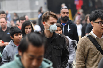Melburnians don masks as the city is enveloped in haze.