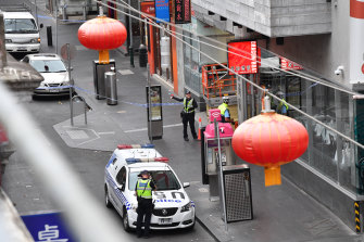 Police at the scene of the killing off Little Bourke Street.