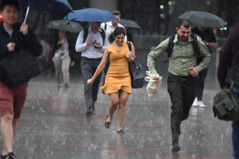 Office workers caught in the downpour on Wednesday afternoon.
