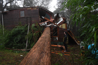 A resident of Olinda, east of Melbourne, was lucky to escape his home after a large tree smashed through his bedroom - missing his bed by less than a metre.