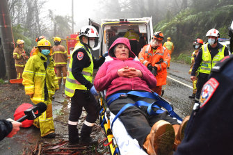 A woman in Olinda is rescued from her house after a tree landed on it.