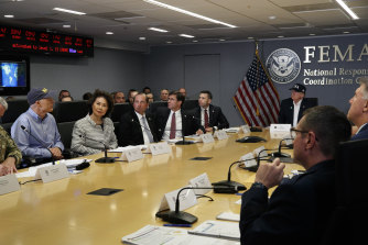 President Donald Trump, right, attends a a briefing about Hurricane Dorian at the Federal Emergency Management Agency on Sunday.