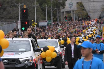 Trent Cotchin and Dustin Martin lead the Richmond cavalcade along a parade route that was, mostly, a sea of yellow and black.