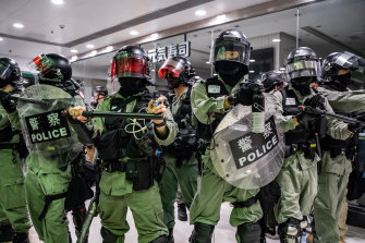 Riot police secure an area after detaining protesters in a shopping mall during a rally in Hong Kong, China.