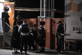 Police take details from people outside a synagogue in Ripponlea last week.