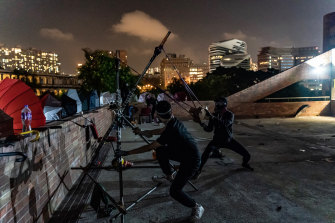Protesters shoot with a catapult during a clash with police at the Hong Kong Poytechnic University on Saturday night.