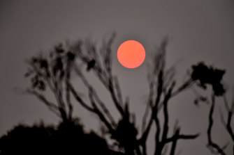 The blood-red sun rises over Moe on Friday.