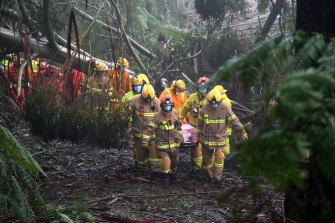Emergency crews rescue a woman in Olinda.