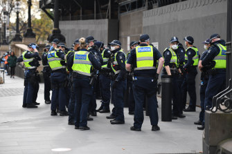 Police gather ahead of the Black Lives Matter protest in Melbourne.