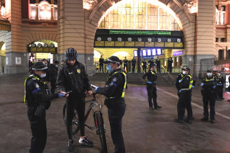 Police out the front of Flinders Street Station on Wednesday evening.