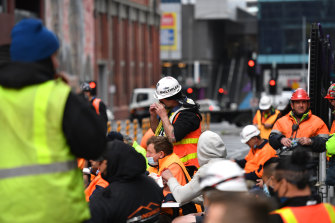 Construction workers blocking Lonsdale Street on Friday.