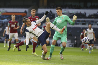 Gareth Bale beats Burnley goalkeeper Nick Pope to score for Spurs.