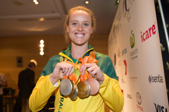 Ellie Cole displays her medals at a press conference at Sydney Airport after arriving back in Sydney from the Rio Paralympics.