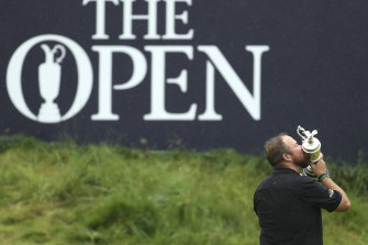 Shane Lowry kisses the Claret Jug after winning the 2019 British Open at Royal Portrush.
