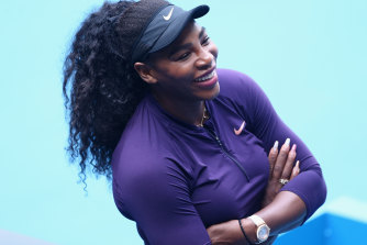 Serena Williams is all smiles after practising at Melbourne Park on Sunday but chose to bypass an official pre-tournament press conference.
