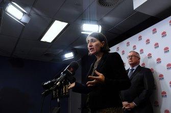 NSW Premier Gladys Berejiklian, pictured with Health Minister Brad Hazzard, addresses the media on Wednesday.