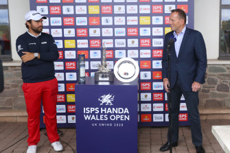Former Australian prime minister Tony Abbott (right) presents the Wales Open trophy to Romain Langasque, of France in Newport, Wales, in August.