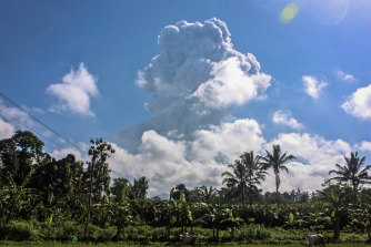 Mount Merapi spews volcanic materials during an eruption as seen from Sleman, Indonesia, on Sunday, June 21.