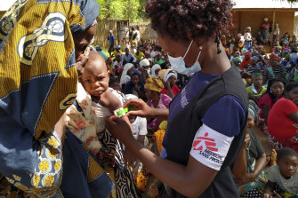 An MSF (Doctors Without Borders) staff member checks a child for malnutrition in Meluco, in the northern Mozambican province of Cabo Delgado, February 19, 2021.